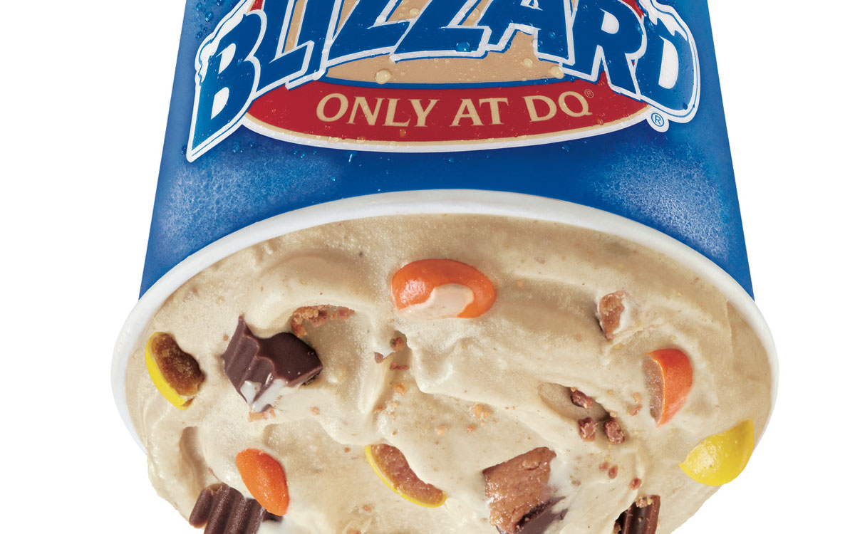 Dairy Queen's Reese's Outrageous Blizzard Treat is a decadent combination of Reese's Peanut Butter Cups, crunchy Reese's Pieces, creamy peanut butter topping, and a layer of warm and sweet caramel topping hand-blended with signature DQ vanilla soft serve
