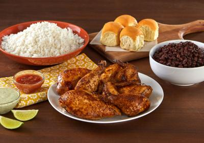 Pollo Tropical chicken platter with sides.