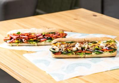 Two footlong Subway sandwiches.