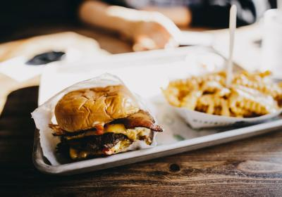 Burger and fries on a tray.