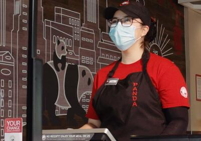 Panda Express employee wearing a mask.