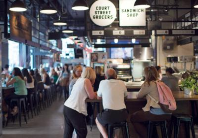 Fast food operators are testing menu concepts at food halls across country.