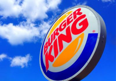 Burger King's iconic sign hangs outside a restaurant.