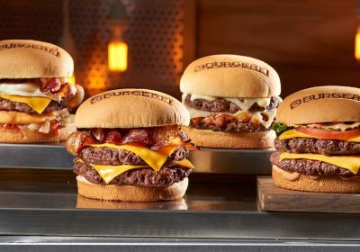 A row of burgers at BurgerFi, a growing fast casual concept.
