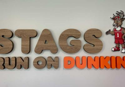Stag run on Dunkin' sign at Fairfield University