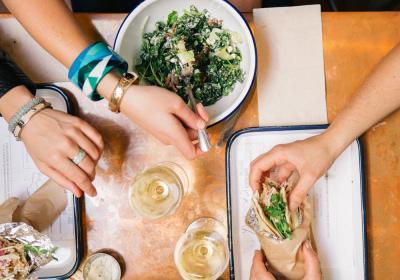 A group of friends enjoying pita sandwiches at Souvla fast casual.