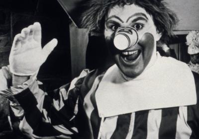 History, Black & white photo of Willard Scott as the first Ronald McDonald.