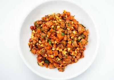 Mexican Chili Roasted Butternut Squash with White Corn, Lime Corn Nuts, and Scallion Ranch Dressing.