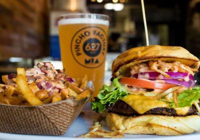 A beer, fries, and a burger at Pincho Factory.