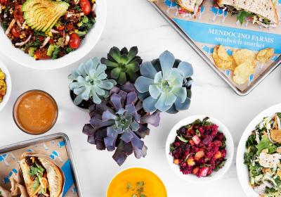 An array of food on a table at Mendocino Farms.