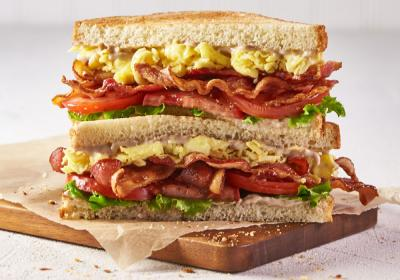 A double decker sandwich with egg and bacon at Corner Bakery Cafe.