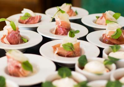 Food plated on a buffet for catering.
