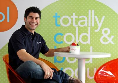 Franchisee Sam Batt poses at a TCBY restaurant.
