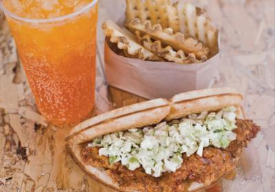 California QSR chain Bruxie offers chicken and waffle sandwich in fast casual restaurant.
