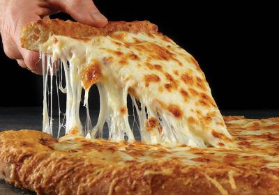 A slice of Papa John's pizza is being lifted by a hand.