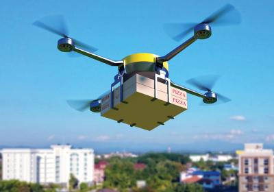 A drone carries pizza boxes.