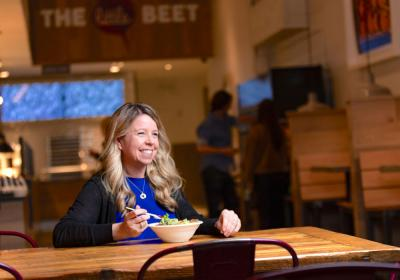 The Little Beet CEO Becky Mulligan eats a bowl of food at the fast casual.