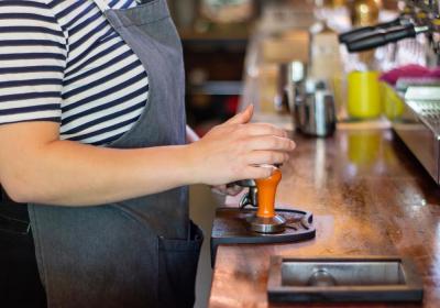 A barista prepares a cup of coffee.