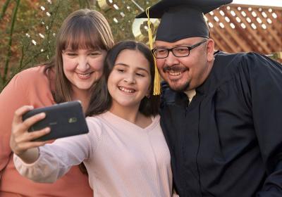 A family takes a selfie.