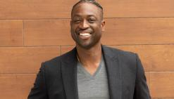 A portrait of NBA superstar Dwyane Wade smiling.