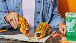 Taco Bell's Quesalupa held by a customer.