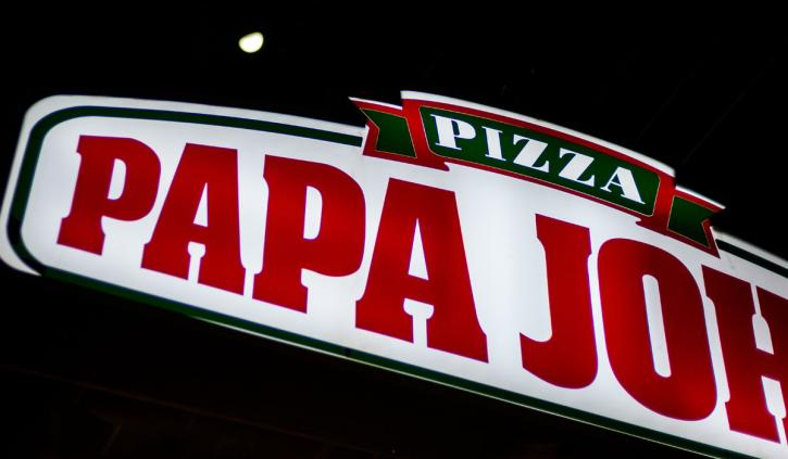 Papa John's logo with a half moon in the background.