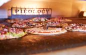 Pieology pizzas in the oven.
