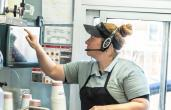 A Good Times worker punches in a drive-thru order.