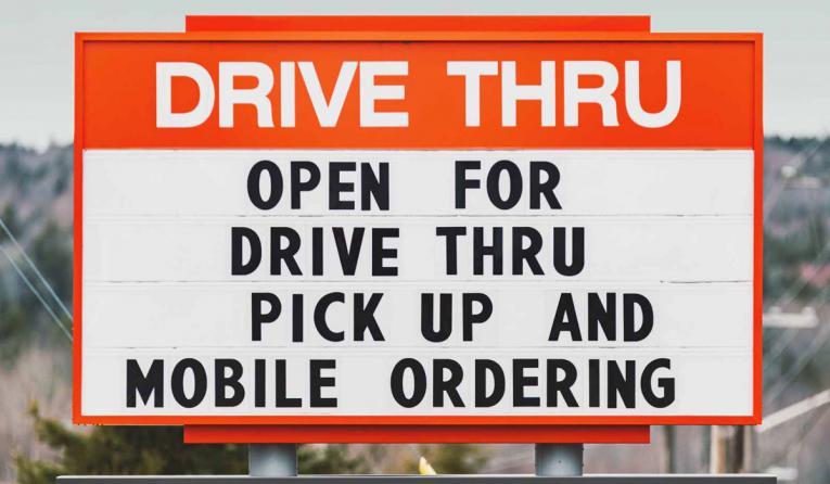 Drive thru sign at a restaurant.