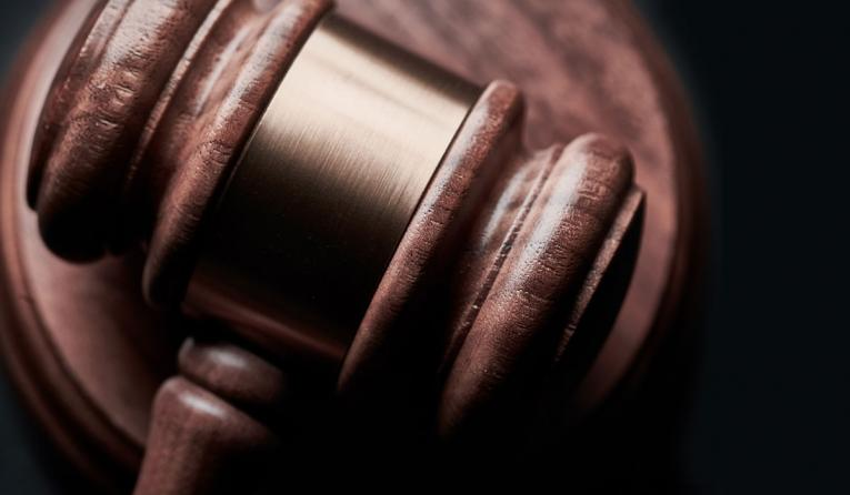 Gavel on a wooden background.