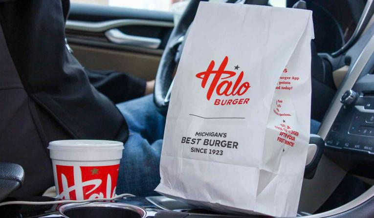 Halo Burger in a bag in a car.