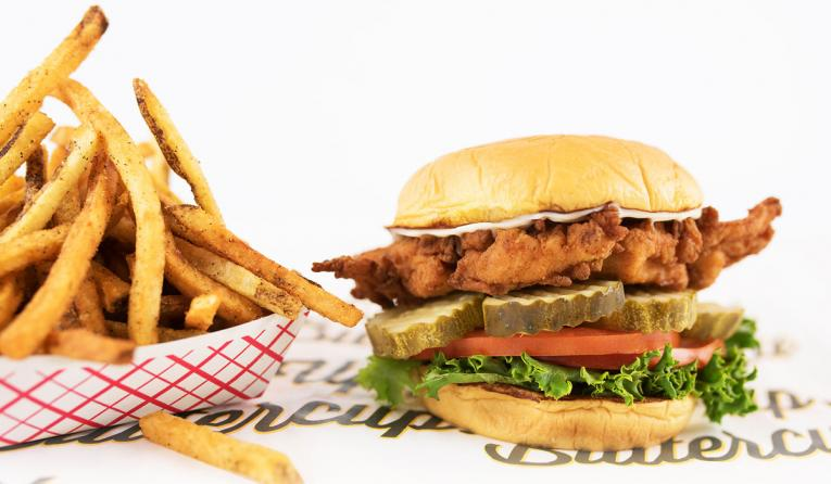 Super Chix chicken sandwich and fries against a white background.