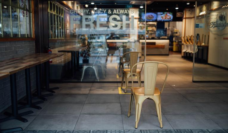 Chair outside an empty restaurant.