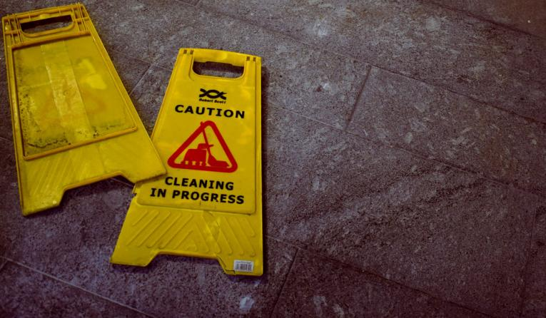 A cleaning sign on the floor.