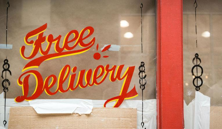 Free delivery sign in a window.