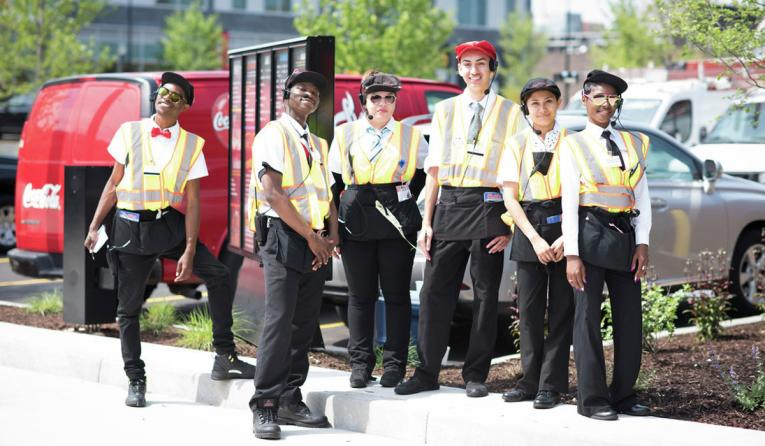 Portillo's drive thru employees pose for a photo.