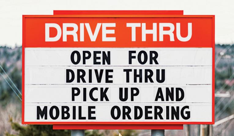 Drive Thru sign with COVID-19 message