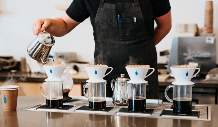 Someone pouring coffee.