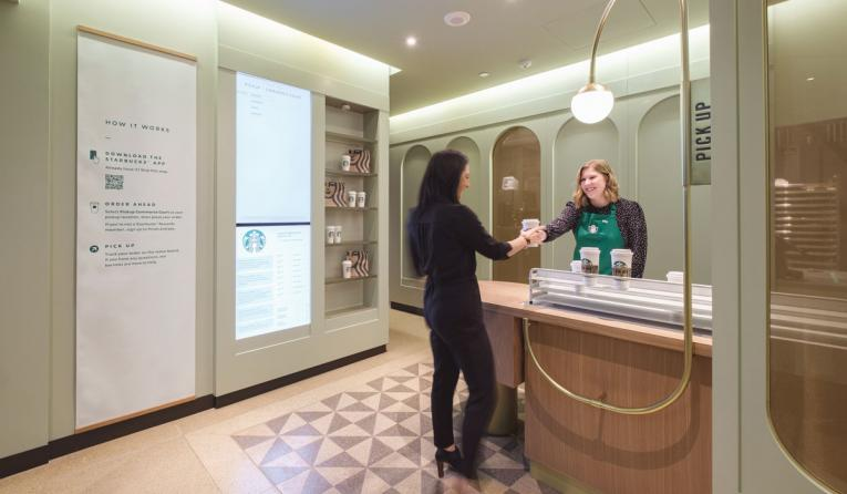 Starbucks Pickup Store, where an employee greets a guest.