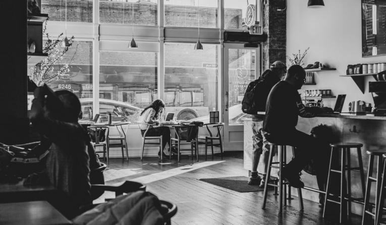 Black and white image of a coffee shop.