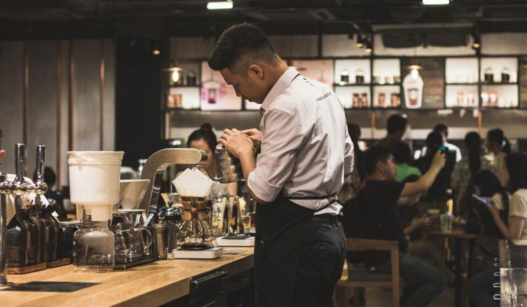 Barista prepares a coffee.
