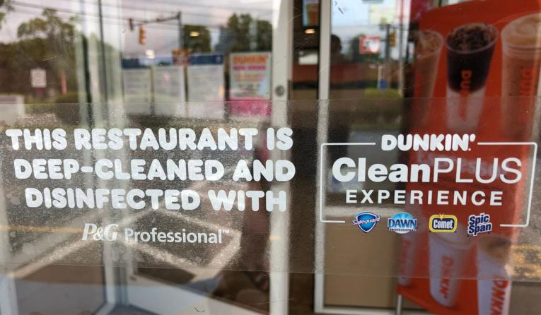 Dunkin' storefront window.