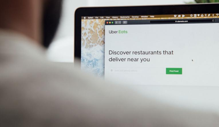 Customer looks at Uber Eats on computer.