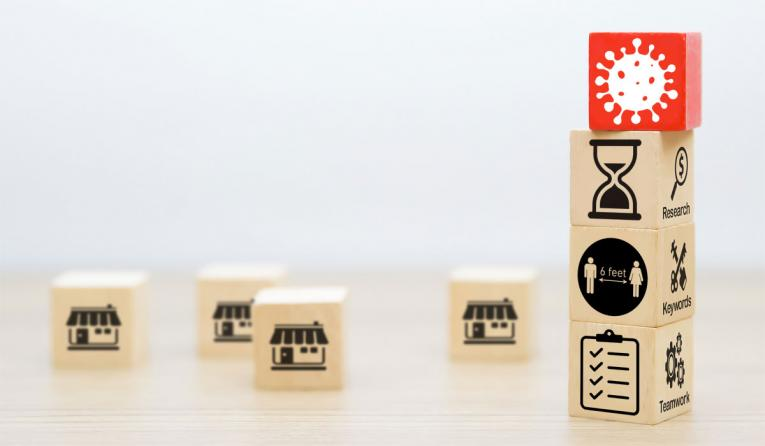 Building blocks with Covid-19 icons threatening restaurants franchising.