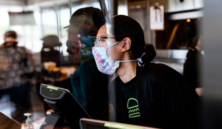 Shake Shack employee with a mask.