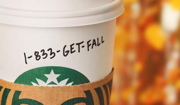 Starbucks cup with fall hotline number.
