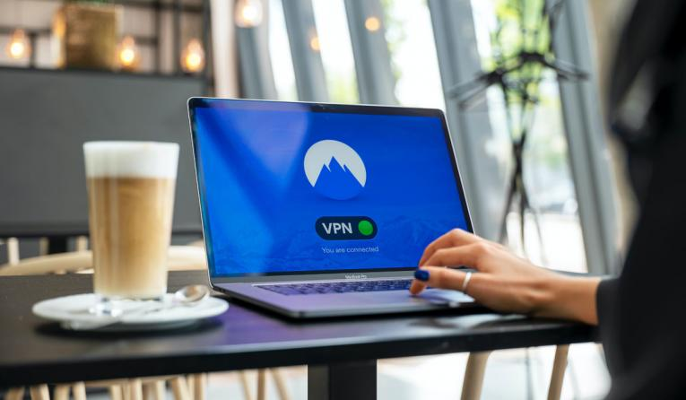 """A computer with """"VPN"""" sits open on a table."""