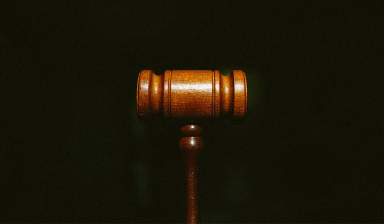 Gavel on a black background.