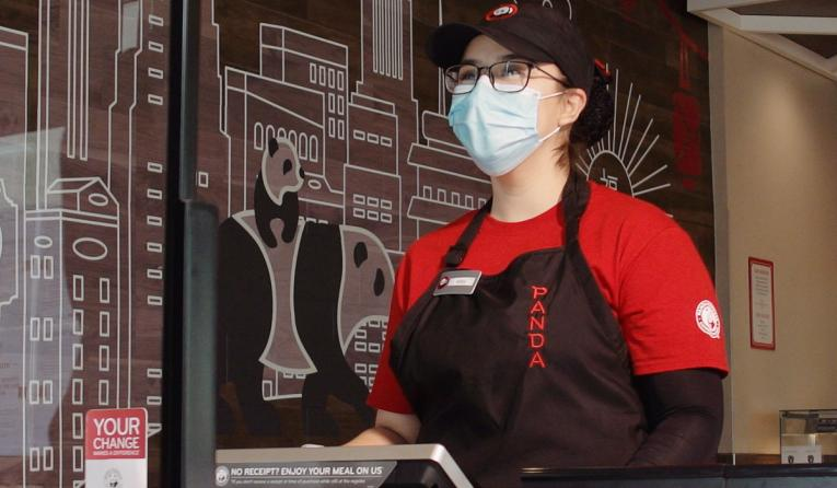 Panda Express employee wearing a mask.