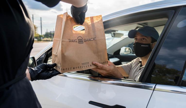 Shake Shack customer getting food in their car.